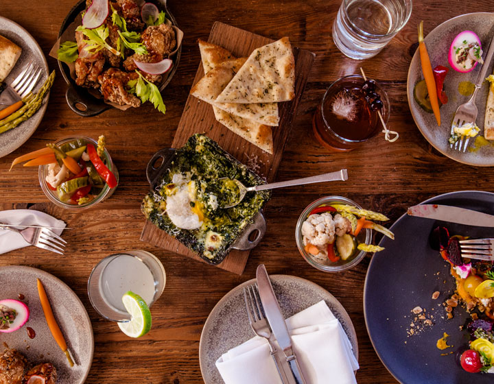 table set with shareable appetizers from finch and fork