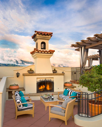 rooftop terrace fire pit with lounge chairs